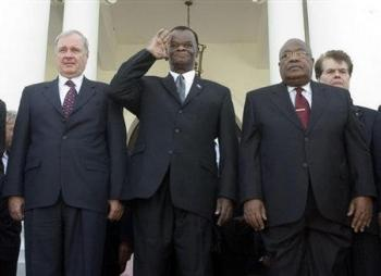 Canadian prime minister Paul Martin, coup-President Boniface Alexandre and coup Prime Minister Gérard Latortue.jpg