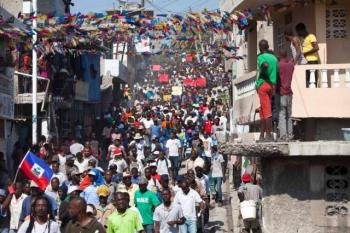 Protesters in Port-au-Prince, Haiti, chant anti-government slogans during a protest Monday against President Michele Martelly's government to demand the cancellation of the Jan. 24 elections. Dieu Nalio Chery AP_0.jpg